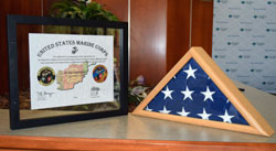 Plaque and American flag presented to Stearns Bank by Wounded Warriors Family Support
