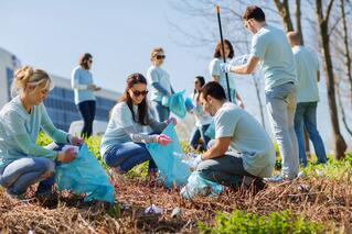 volunteers with garbage bags cleaning park area-1.jpg