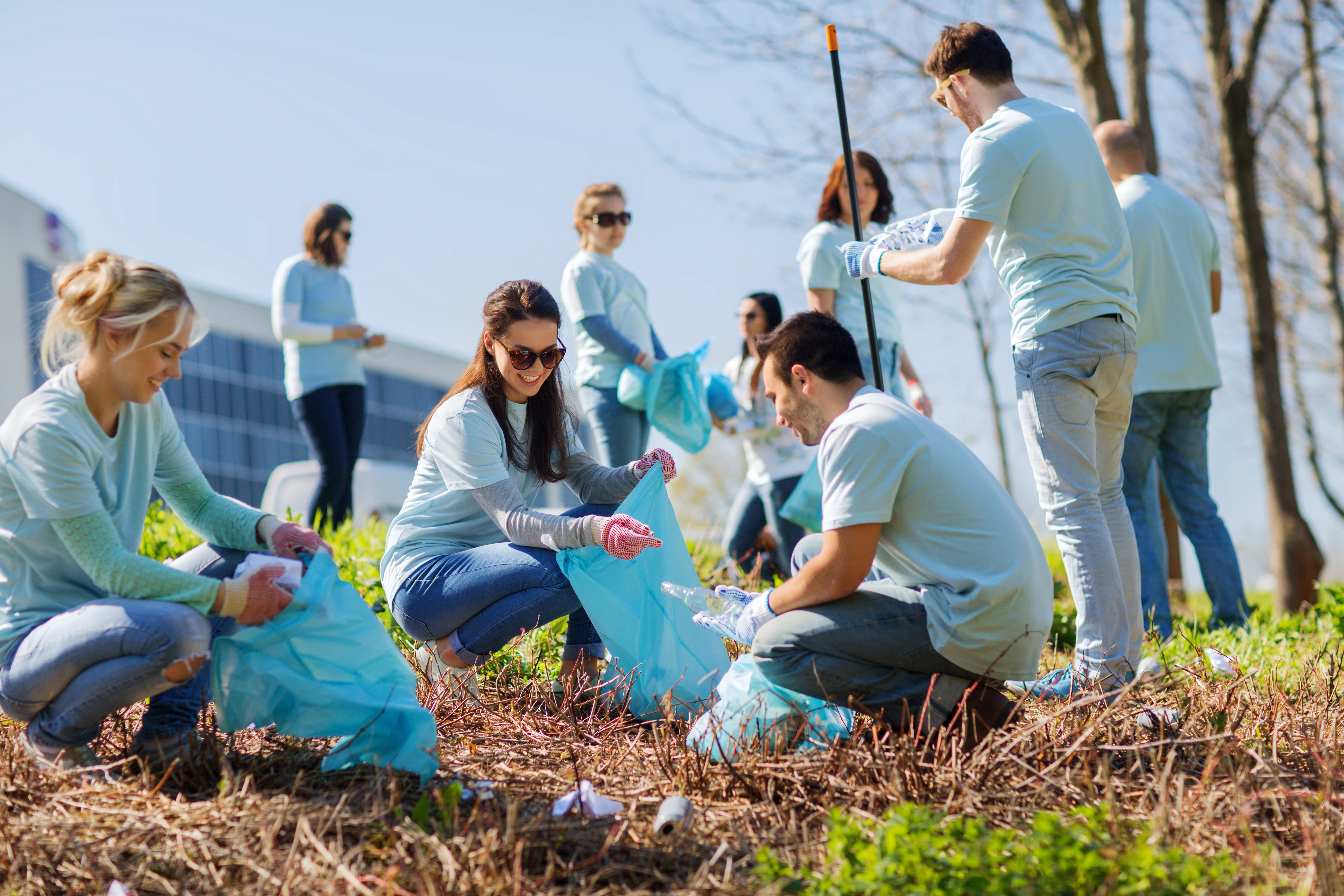 volunteers with garbage bags cleaning park area-1.jpg
